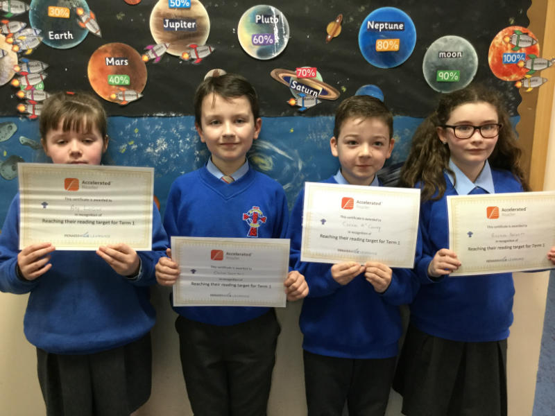 Amy, Oisin, Cormac and Roisin with their reading certificates for reaching their targets.